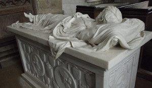 Grave statue of figure sleeping